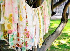 This is a sweet idea for hanging outside at a party or a shabby chic window covering - strips of fabric remnants or sheets, etc.