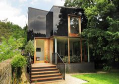 Tree House: Ian McChesney Unveils The Black Glass-Clad House in South-East London