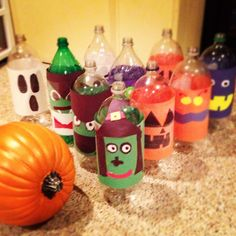 Great idea.  Construction paper over the bottles.  I wouldn't use them empty for bowling, but for the drinks table, yes.