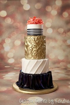 Multi-layered wedding cake - with a unique color and design in each tier #wedding #weddingcake #cake #gold #blackwhite