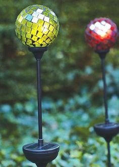 Add some sparkle to your backyard with these mosaic multi-colored, solar-powered globe lights!