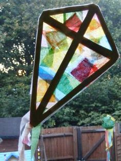 Stained Glass Kite Craft...i wanna try this for a window that has sun but the blinds rarely get opened because they face the next door neighbors house that's like 5ft away kp
