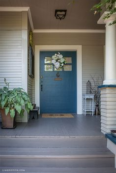 Lia Griffith's Craftsman covered front porch: paint is Sherwin-Williams...Emerald Exterior Latex in Satin in Seaworthy #7620 (teal) for door + trim | Porch and Floor Enamel in Folkstone #6005 (mushroom brown) for steps and deck