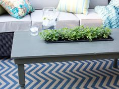 After touching up the home's curb appeal, it was time to move to the backyard.  Adding your own custom touch to a store bought item is a great way to achieve a designer look.  For the deck of the HGTV Spring House, I retrofitted this outdoor coffee table into an herb garden-->http://hg.tv/y8b9