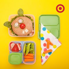 All you need is a bagel sandwich and some fruits and veggies to make a silly looking lunch that looks right back.