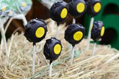 Love these Tractor Tire Cake Pops from a John Deere Farm themed birthday party via Kara's Party Ideas KarasPartyIdeas.com #johndeere #farmparty #johndeereparty #boypartyideas #tirecakepops
