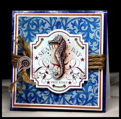 Masculine card designed by Kazan Clark using our Scrolled Vine Background Stamp with Sea Shell Bay.  Love the Red White an blue theme.
