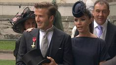 In this image taken from video, England's soccer star David Beckham, left and his wife Victoria arrive at Westminster Abbey for the Royal We...