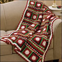 Crochet Christmas Blanket - http://www.ravelry.com/patterns/library/snowflakes--ribbons-throw