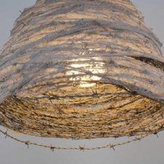 Barbwire lamp....now I know what to do with all of it lying around...use it for art!