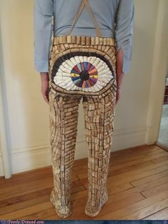 Cork. Pants. Those two words alone are enough to send me into laugh spasms, but then he threw in the artfully painted eyeball butt and now I can't breathe.