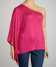 Give that casual closet some easygoing edge! This bold top is covered in shiny studs, with a bold bare shoulder and flowing cape sleeve.