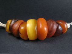 9 ANTIQUE NATURAL AMBER beads. MOROCCO