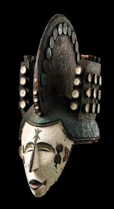 "Africa | Helmet mask ""agbogho mmwo"" from the Igbo people of Nigeria 