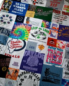 t-shirt quilt - wanna do w my old tshirts someday!
