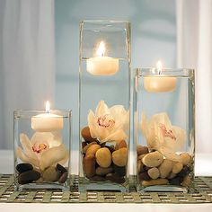 3 square vases with floating candles