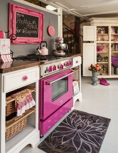Pink painted kitchen...I would do this, but I have a feeling I would hear a lot of complaining!!