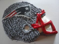 New England Patriots helmet cake.   Football Birthday cake photos. The best football cakes on Pinterest and the best football cakes on the web! Football cake ideas such as Football Stadium cakes, football field cakes, football helmet cakes, and football logo cakes. #football #cakes #gifts