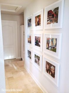 Family photo wall gallery with white frames