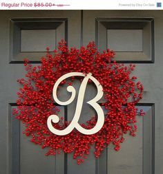 red berry wreath w/monogram_january/february front door