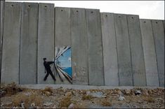 Banksy's painting on the separation wall, Palestine.