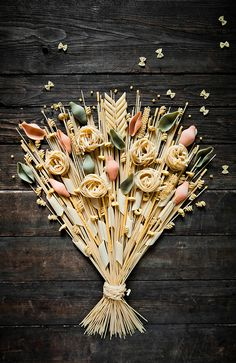 WE LOVE FOOD. by Marion Luttenberger You could mix some flour and water. Then each decorative noodle art can get coated with the flour and water and then layed. Put in a shadow fame and you made a piece of art! A one of a kind, and low cost gift. It could be placed in the kitchen!
