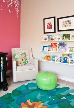 Adding a grouping of fun art prints above your library wall adds a punch of personality!