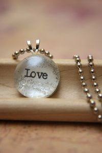 Create a Bubble Charm Pendant with a photo or saying...and spend less than one dollar to make it!