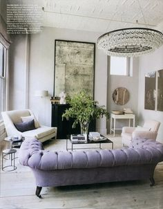 Tufted sofa & chandelier