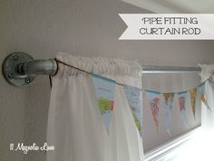 Easy tutorial to DIY a curtain rod out of galvanized pipe and pipe fittings.  Great industrial look for your window treatments--or perfect for a tween or teen boy's room.