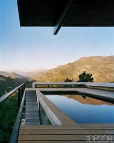 For a hillside home outside Santiago, Chile, architect Max Núñez designed a minimalist pool terrace to take advantage of the views of the surrounding forests and glaciers. The deck is made of weathered teak, and the floating bench is cast concrete.