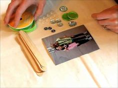 Learn how to make Craft Stick Photo Frames and add bottle caps! bottle-cap-inc-popsicle-stick-frames.wmv