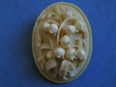 Lilly-of-the-Valley Ivory Brooch is a superb example of the art of Victorian carving. Captured with life-like details, each tiny bell shaped flower and leaf reveal the talent of a master carver.