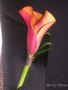 Prom Flowers - A mango mini calla lily accented with foliage and just a hint of gold wire make this a modern and unique boutonniere.