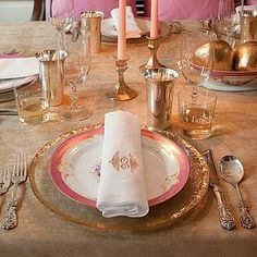 Family-Style Thanksgiving Table | We love this Champagne and gold color palette with touches of pink—perfect for Thanksgiving dinner. | SouthernLiving.com