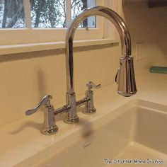 Lauren of The Starter Home Diaries completed her budget kitchen makeover with our Pfister Ashfield Bridge Faucet!