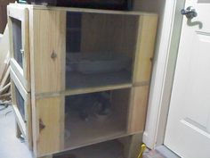Litter Box enclosure in the garage, accessed by pet door in the wall