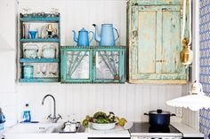 : Turquoise and greens in a beautiful Swedish cottage kitchen