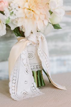 bouquet tied with ribbon and lace, photo by Apryl Ann Photography http://ruffledblog.com/romantic-hickory-street-annex-wedding #weddingbouquet #flowers