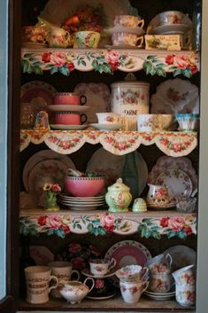 Use cut out vintage wallpaper for shelf trim.