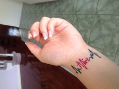 """""""Alive"""" tattoo with ECG tracing"""