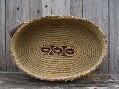 Coiled Pine Needle Basket with Walnut Slices-Oval in shape. $175.00, via Etsy.
