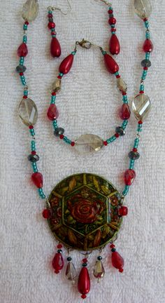 This is my parure for this months challenge the centerpiece is a B'sue piece done in alcohol inks and chain is glass pearls, crystal and seed beads.
