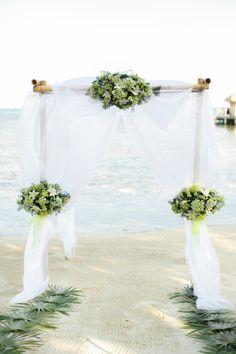 Beautiful beach chuppah: http://www.stylemepretty.com/destination-weddings/2014/06/27/intimate-belize-wedding/ | Photography: Alea Lovely - http://alealovely.com/