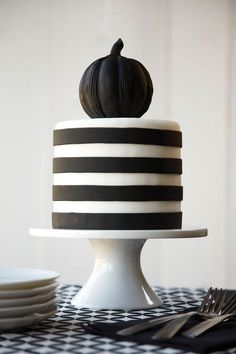 The darkness dazzles on this  Black and White striped Halloween Pumpkin Cake.