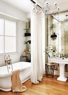 Bathroom with antique mirrored wall