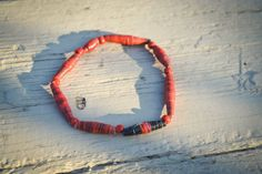 $4 (plus shipping) Recycled Paper Bead Elastic Bracelet.    With each purchase help fight HIV/AIDS and provide clean drinking water to those struggling in Africa. 10% of each purchase will be donated to Blood:Water Mission.