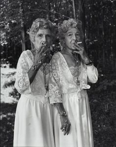 Just some old lady twins smoking in black and white.