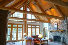 rustic interior with exposed log trusses