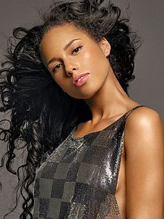 Alicia Keys - Although I may not agree with some of the choices she's made (and no I'm NOT talkin' about Swizz Beats! LMAO!) I believe that Alicia is an amazingly beautiful and talented artist. The Element of Freedom is STILL one of my favorite albums to date...the girl is BAD!